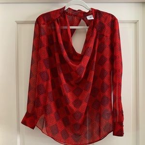 Red patterned sheer blouse with cool cutouts